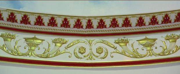 gold and colour detailing on cornice